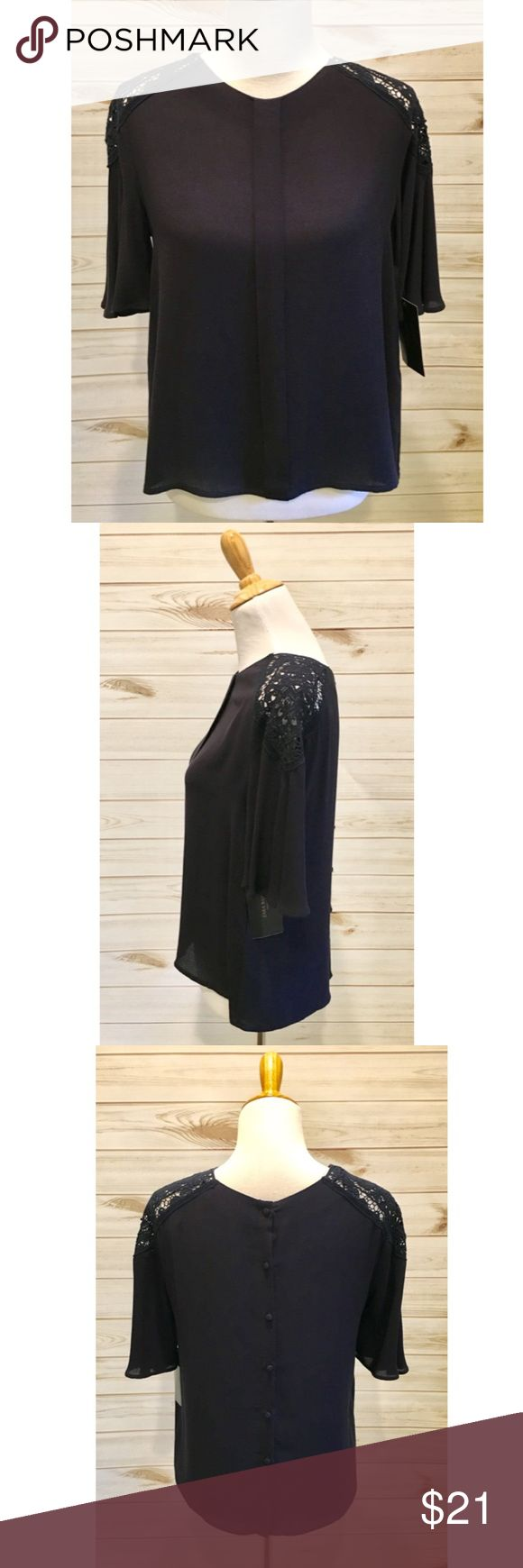 """NWT Zara Basics Navy Crochet Short Sleeve Top NWT Zara Basics short sleeved top. Size M. Beautiful navy blue color with crochet detailing on each shoulder. Buttons line the back of the shirt for an added touch.  Bust: 20"""" pit to pit laying flat  Length: 22.5"""" from shoulder Zara Tops"""