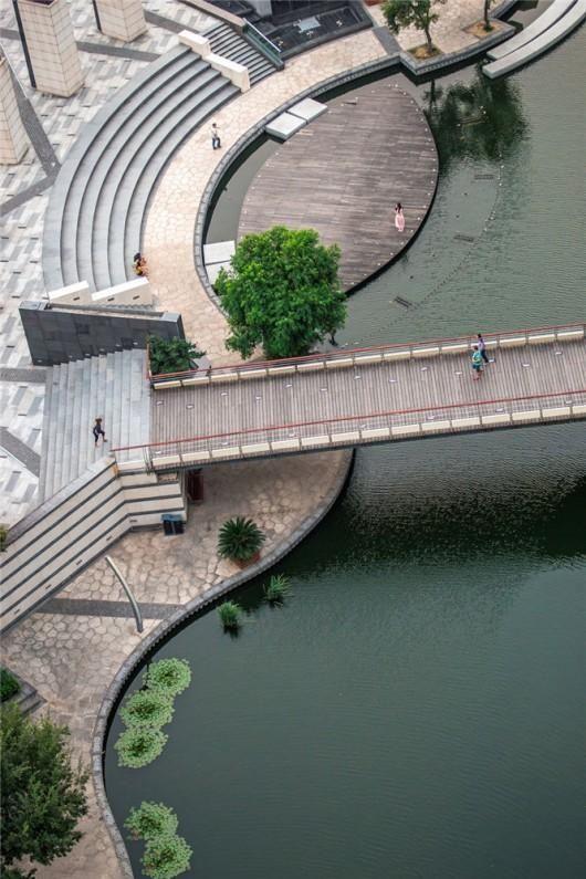 Pedestrian bridge across the Zhangjiagang River, Suzhou, Jiangsu, China by Botao Landscape. Click image for more views and visit the slowottawa.ca boards >> http://www.pinterest.com/slowottawa/boards/