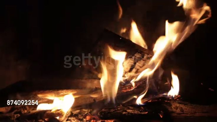 Burning firewood in the fireplace. View and buy the video on conditions Royalty-Free: http://www.gettyimages.com/license/874092254 #gettyimages #getty #fireplace #background #fire #flames #microstock #royalty #royaltyfree #video #videos #postproduction