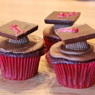 Edible Graduation Caps (upside down reeses peanut butter cups, ghiradelli chocolate squares, pipe red chocolate tassels, red mini m for button