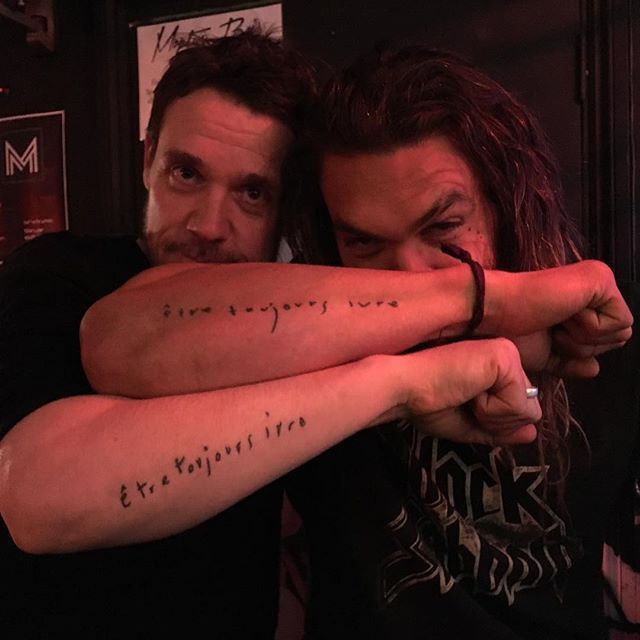 """Pin for Later: Your Comprehensive Guide to Jason Momoa's Many Tattoos Right outer forearm tattoo that reads """"Etre toujours ivre"""" Jason and stepdaughter Zoë Kravitz have matching ink, which roughly translates to """"be always drunk."""""""
