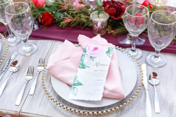 Place setting from a berry hued wedding inspiration