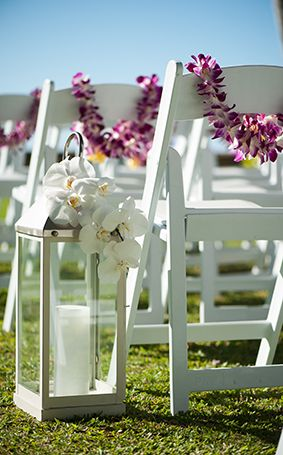This simple outdoor ceremony was accented beautifully by lanterns and orchids