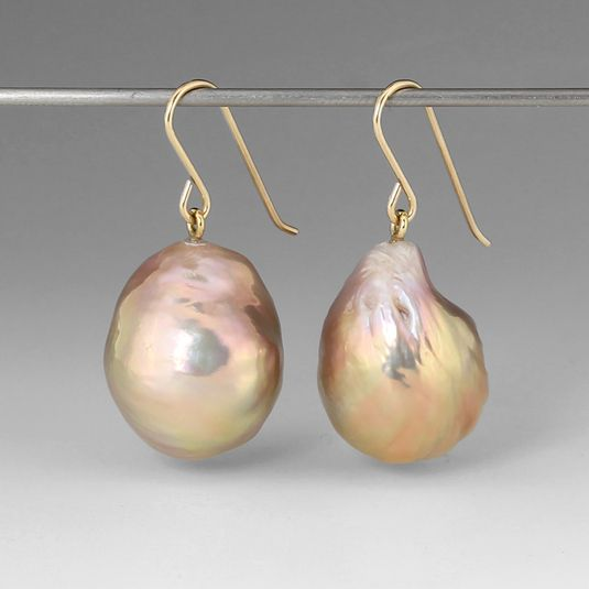 "Maria Beaulieu strives to find the most exquisite specimens to create her jewelry, as seen in this pair of ""Souffle"" pearls in metallic pink tones.  The irregular shape and high luster make these one of a kind earrings stand out!  The freshwater baroque pearls hang on 18k yellow gold hooks. Pearls measure approximately 15mm  x 19 mm."