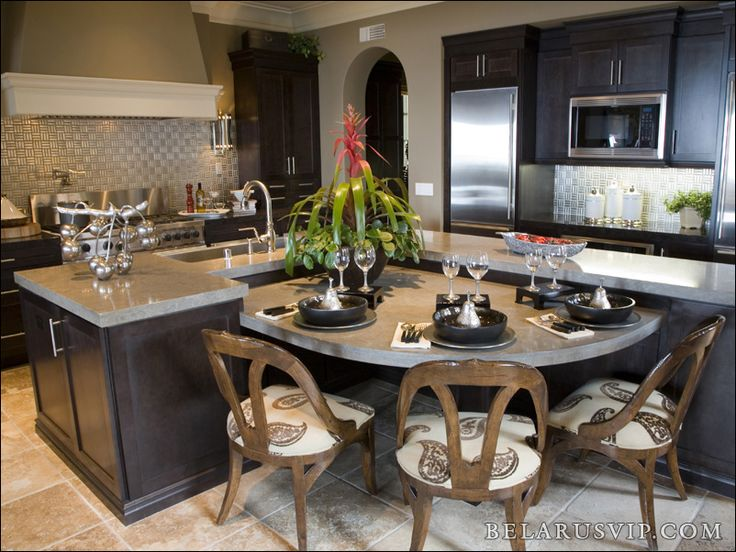 This Transitional Luxury Kitchen Features Espresso Shaker Cabinets A Metal Tile Backsplash And Large Uniquely Shaped Island Table