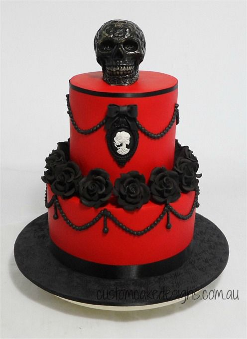 - This cake was made for my clients best friend who wanted a tasteful Gothic themed cake that had red, black and skulls – so this is what I came up with :) The top skull is a white chocolate skull that has been airbrushed black and the skull cameo is fondant.  The cake is made from choc mud and caters for approx 80 coffee / 40 desert size portions.