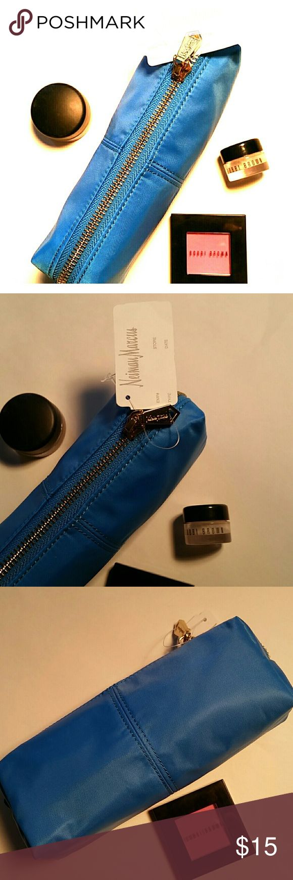 "Neiman Marcus cosmetic bag Great small cosmetic bag  7"" x 3"" x 2"" Blue (More like the first photo ) Brand new! Perfect for traveling or a night out. Neiman Marcus Bags Cosmetic Bags & Cases"