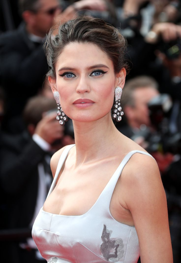 Bianca Balti wore a floor length floral gown with de GRISOGONO black and white diamond earrings, with an up do hairstyle. For glamour celebrity fashion Cannes Film Festival red carpet jewellery spotting travel here: http://www.thejewelleryeditor.com/jewellery/top-5/cannes-2017-red-carpet-jewellery-70th-anniversary-party/ #jewelry