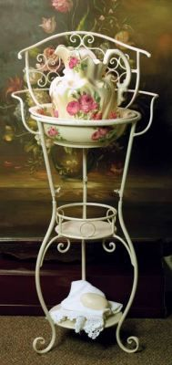 "Victorian Wash Stand & Roses Pitcher with Bowl    Pre-dating indoor plumbing, this makeshift ""sink"" assisted with bedroom bathing. Towels and soaps were stashed on lower shelves and water was poured into the basin from a pitcher for a sponge bath."