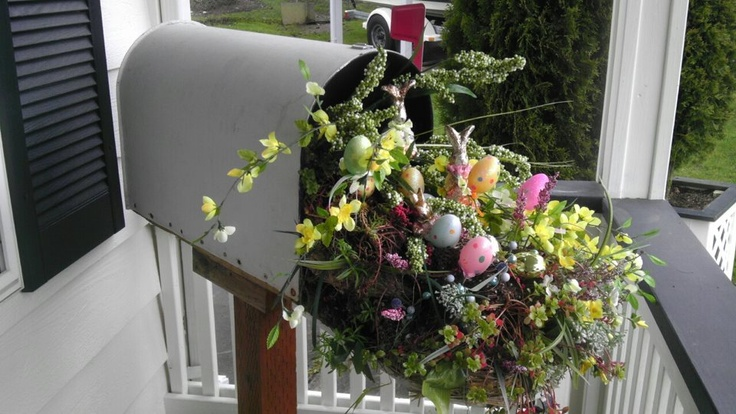 Old mailbox converted to a porch planter box. Filled with succulants and season accents. Here's Easter time for ya.