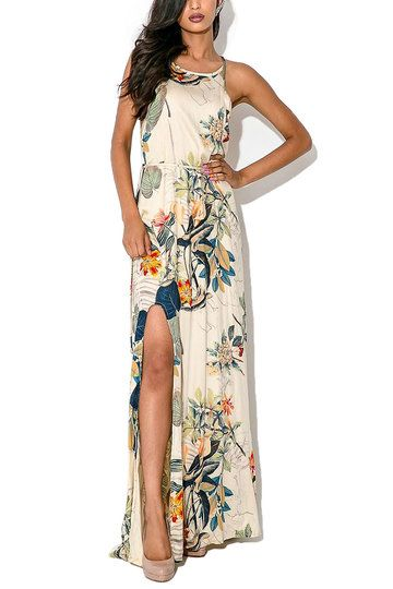 Contrast the leaf print of this maxi dress with its soft flowing cut, and you have one confident look. Designed with a square neck and back, high side split, trazepe shape and luxe crepe fabric, this billowy gem is classic glam.