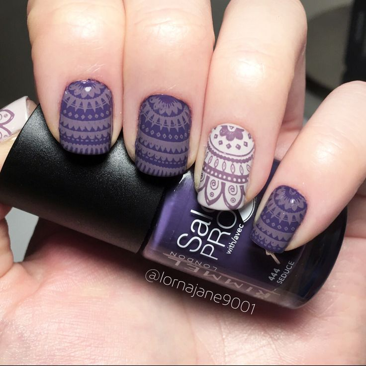Purple patterned nail art using @rimmellondonuk 'seduce' & @barrymcosmetics 'pit stop' quick dry polish. With @moyou_london stamping polish 'purple mouse' & stamping plate 'kaleidoscope plate 07'.
