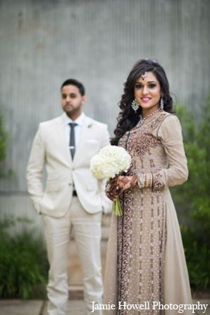 A south Asian bride and groom marry in a traditional Muslim wedding ceremony. They celebrate many Muslim traditions with friends and family throughout the glamorous festivities.