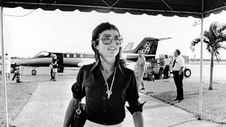 The former First Lady (who would have been 86 today) was unfailingly first in flight. Here's how to channel her consummately chic look.