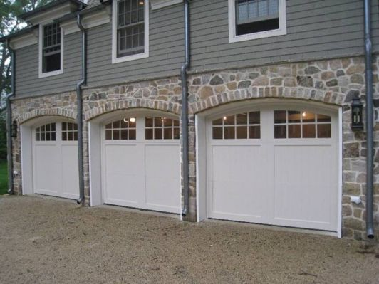 carriage garage doors with arched windows