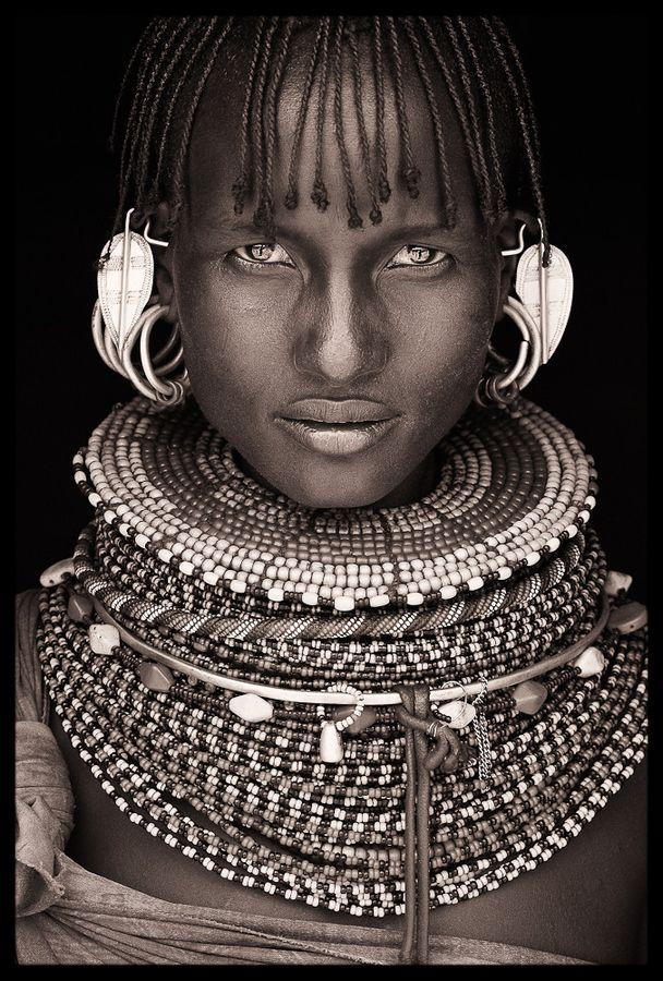 Mumuhuila tribe of Angola. All these photographs are just beyond my grasp of different cultures out there. Pretty awesome!!! :)