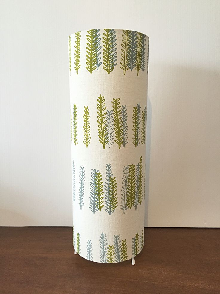 Little Forest Cylinder lamp  Hand screen printed hemp & organic cotton.  Made up into a table lamp.  Perfect for bedside table or sideboards.  Assembled in Wellington  $ #ecolampshades #hemp #organiccotton #vidatextiles #verdantdesign