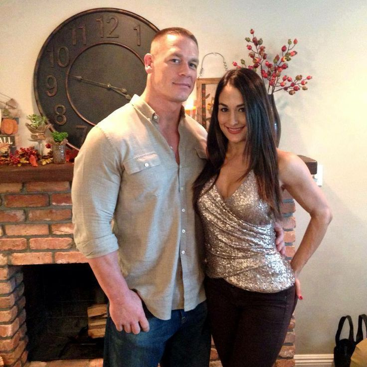 John Cena (left) pictured with his girlfriend Nikki Bella. John Cena is an American professional wrestler, rapper and actor signed to WWE, the current WWE United States Champion in his fourth reign, and public face of WWE, serving as its franchise player since 2005. Released a rap album You Can't See Me. Starred in films; The Marine (2006), 12 Rounds (2009), and Legendary (2010).