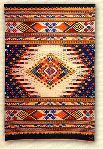 Weaving by Arnulfo Mendoza of Oaxaca, Mexico.  I love his designs and colors!: