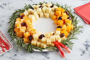 Easy Cheese Wreath  Arrange a variety of delicious, creamy cheese cubes in a circle, add olives, and you've got yourself a simple, elegant appetizer.