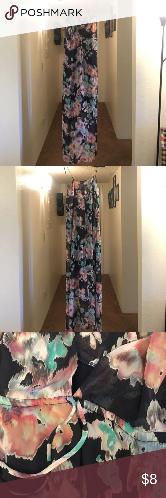 Sheer floral maxi dress Dark blue and pastel maxi dress. Has spaghetti straps that can be untied and adjusted, as well as a tie around the front to cinch it in. Pretty low cut v neck. Liner on inside of the dress stops at about mini dress length and rest of fabric is sheer. Only worn a few times. No sings of damage or wear. Forever 21 Dresses Maxi
