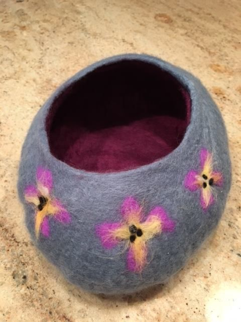 Shaped felted Pansy Vessel created by Kathy Welter during #LearnToFelt, an online class. Kathy learnt how to felt bowls and other hollow objects in week 3 but this fabulous design is from her own imagination! Discover the artist within with a fabulous group of fiberistas from around the globe. www.LearnToFelt.com