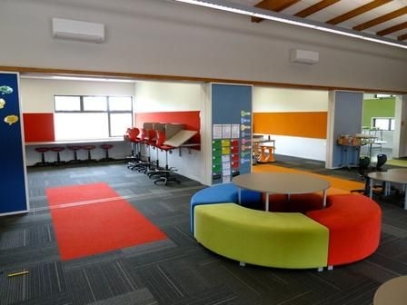 Hingaia Peninsular Learning Spaces. red room for individual, introspective learning - THIS furniture!