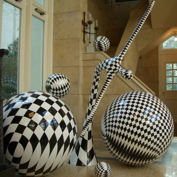 Sphere sculpture and the harlequin by the sculptor Vassiliki. photo taken in her studio.