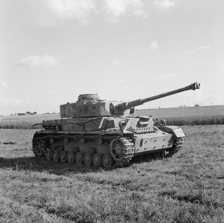 BRITISH ARMY NORMANDY 1944 (B 6345)   A captured German PzKpfw IV tank( long barrel gun version) at 27th Armoured Brigade workshops, 3 July 1944. This vehicle had the turret number '612'.