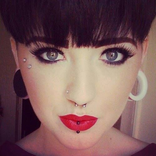 I've never really been a fan if surface piercings, but that one by her eye is gorgeous on her.