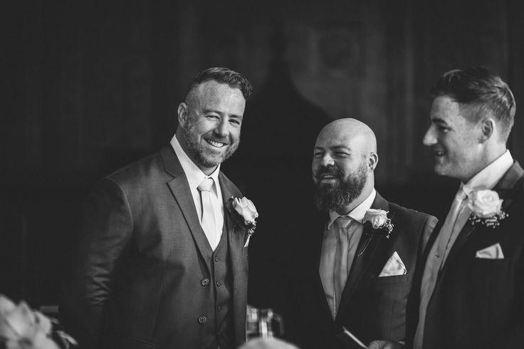 The gents scrubbed up well! Photo by Benjamin Stuart Photography #weddingphotography #suits #groom #groomsmen #weddingday #gentlemen #buttonhole #blackandwhite #smile