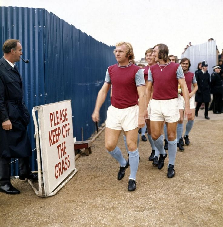 West Ham players Bobby Moore and Billy Bonds walk out onto the pitch at Stamford Bridge in September 1972