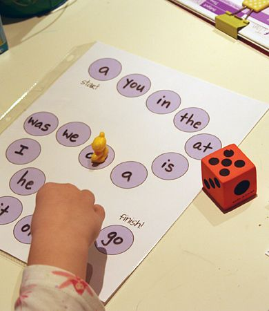 Homemade Sight word Board game! Vary the game--put a marker on the word when it is learned and fill the board with markers.  Use cheerios they can eat afterwards.