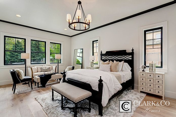 "Clark & Co Homes - 2016 Spring Parade Home ""The Heartland"". Modern Farmhouse. www.clarkandcohomes.com. Built-in cabinetry; White Dove by Benjamin Moore; Black Magic. Master bedroom sitting room. Impervia windows by Pella. Shaw white oak engineered flooring. Black crown molding."
