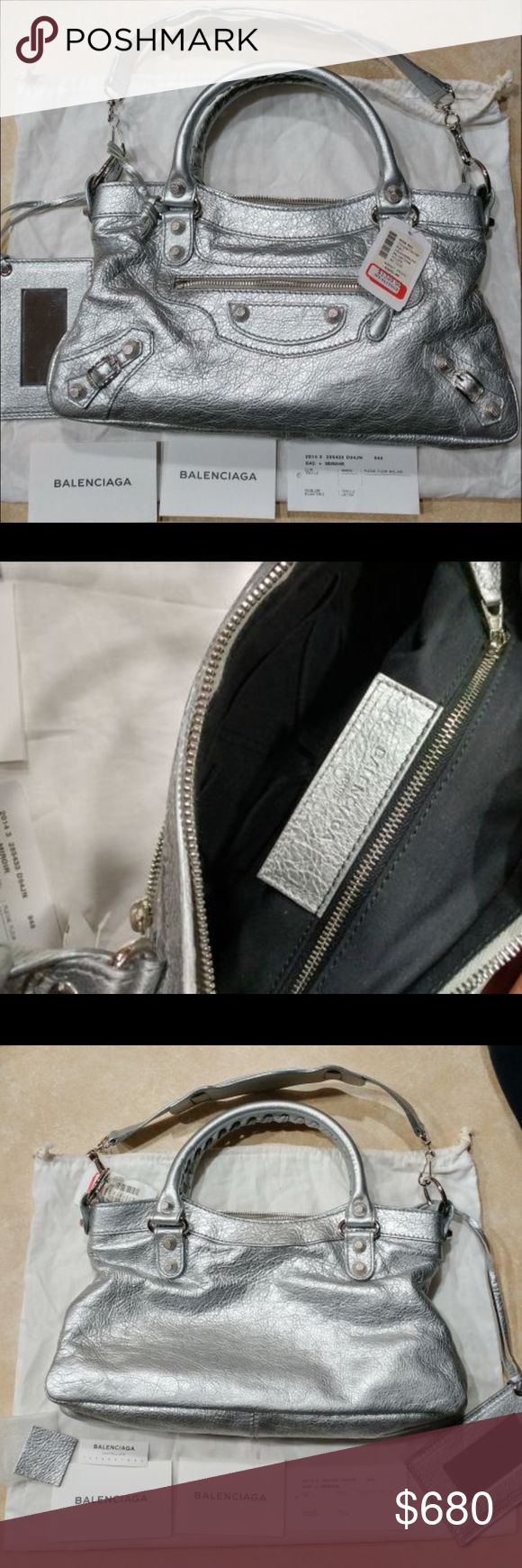 Balenciaga silver shoulder bag Authentic with tags attached .. never used ! Bought it on sale but never used it .. Balenciaga Bags Shoulder Bags