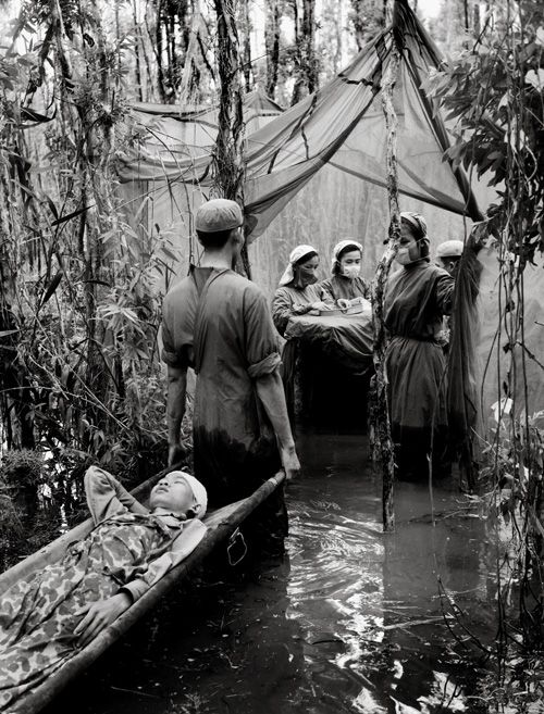Vo Anh Khanh  A Cambodian guerrilla is carried to an improvised operating room in a mangrove swamp in this Viet Cong haven on the Ca Mau Peninsula  1970