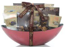 Godiva Chocolatier Gift Basket.Get lost in the rich flavor of a Godiva® chocolate or in of cup of chocolaty hot cocoa.