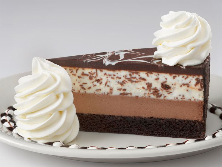 Chocolate Tuxedo Cream™ Cheesecake from the Cheesecake Factory. Fudge cake, chocolate cheesecake, vanilla marscapone mousse and chocolate ganache. I already know how to make the bottom two layers, just gotta perfect the top two.