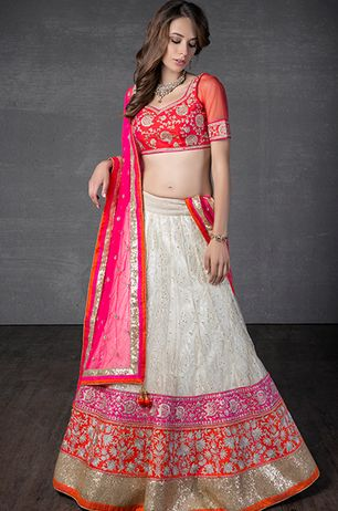 Lucknowi net ghagra with net dupatta and rawsilk blouse embellished with zari