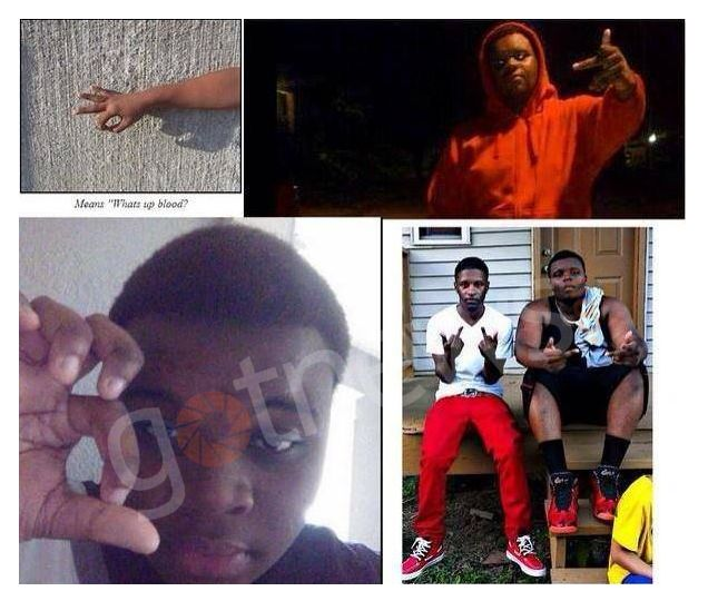 Michael Brown can be seen flashing Blood gang signals in these photos. #ferguson