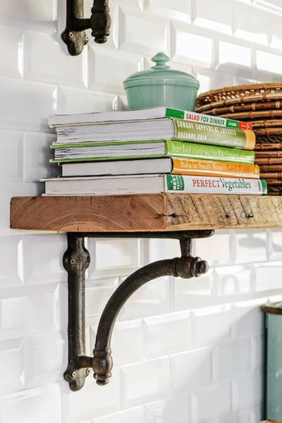 This pin features the popular Restoration Hardware iron shelf brackets. The raw wood slab shelf gives a farmhouse look with a rustic/industrial feel.