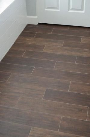 Ceramic tile that looks like wood for the bathroom. by doreen.m