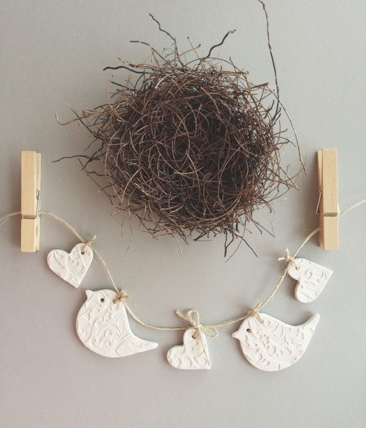 a gorgeous set of embossed mud birds hung as a garland or use each tag individually as a special touch to your gift wrapping.  2 x large bird measures approx 6.5cmx4.2cm 3 x little hearts approx 4cm comes on a length of natural twine  my adorable mud tags can be used to tie to your gift wrap on a special gift adorn a gorgeous table setting..tie around napkins & cutlery tie around vases, candles, jars & bottles hang & decorate your nest!   each tag is individually handmade with ...