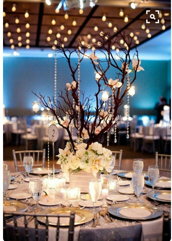 Enchanting decorations for the tables. Great idea for indoor reception as well. I love the branches and the lighting / candles