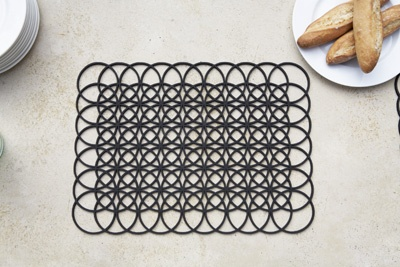 Links Placemats - Kain Lucas: These placemats are both handsome and practical. Made of polyethylene, dishwasher safe and available in black and white.