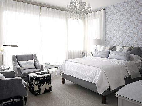 bedrooms - gray blue cole & son wallpaper gray velvet bed white gray striped pillows gray velvet chairs cowhide ottomans gray blue bedroom rug sheers blue silk lumbar pillows