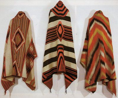 """Left to Right: Navajo Classic Serape with all natural dyes, c. 1860, 73"""" x 52"""", Navajo Third Phase Chiefs Blanket with Ravelled Bayeta, Cochineal, Lac and Indigo dyes, c. 1870, 50"""" x 76.5"""", Navajo Transitional textile, c. 1880, 73"""" x 53"""""""