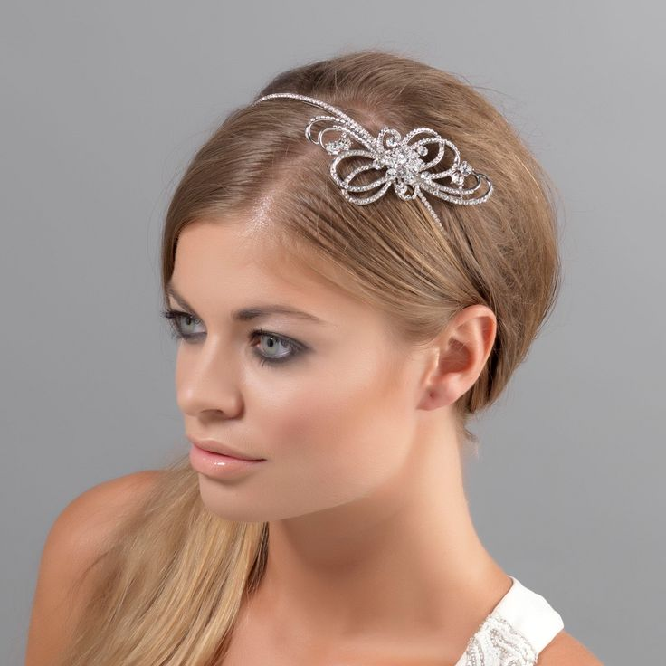 Bejewel your hair with Ribbons of Beauty Side Tiara for 1950s vintage style. View this piece and Glitzy Secrets entire collection of wedding side tiaras online.
