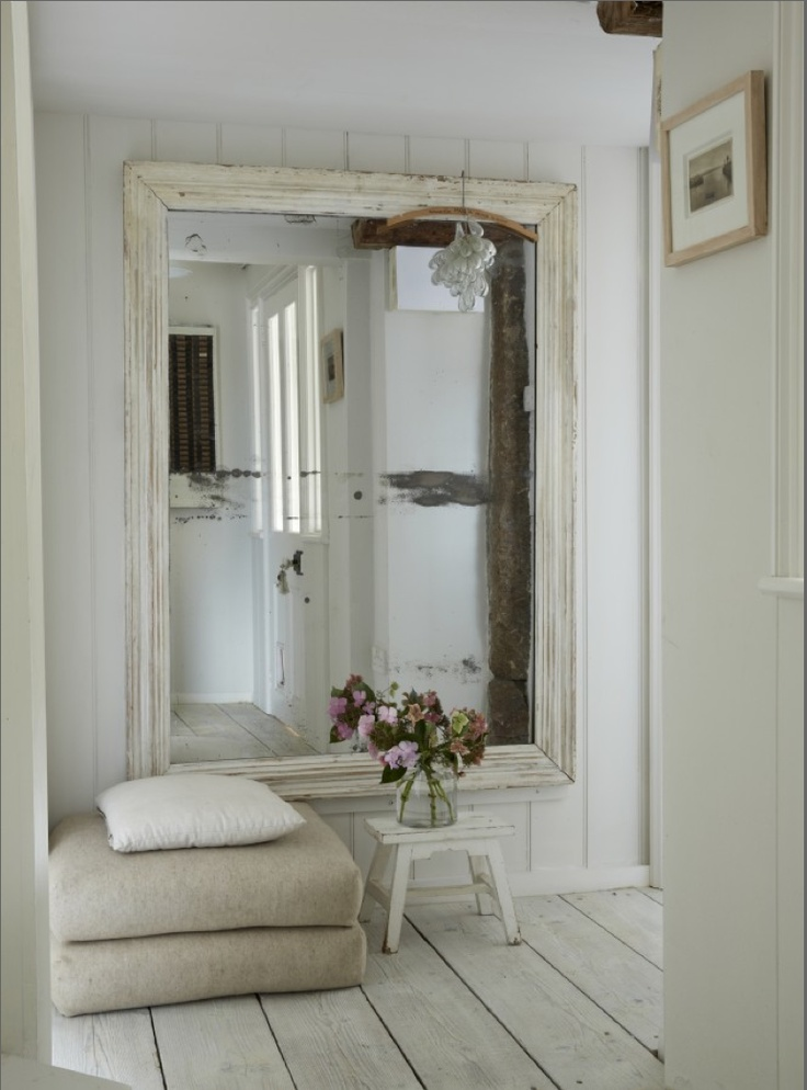 giant mirror opens up room, but when it is vintage distressed, it looks much more subtle