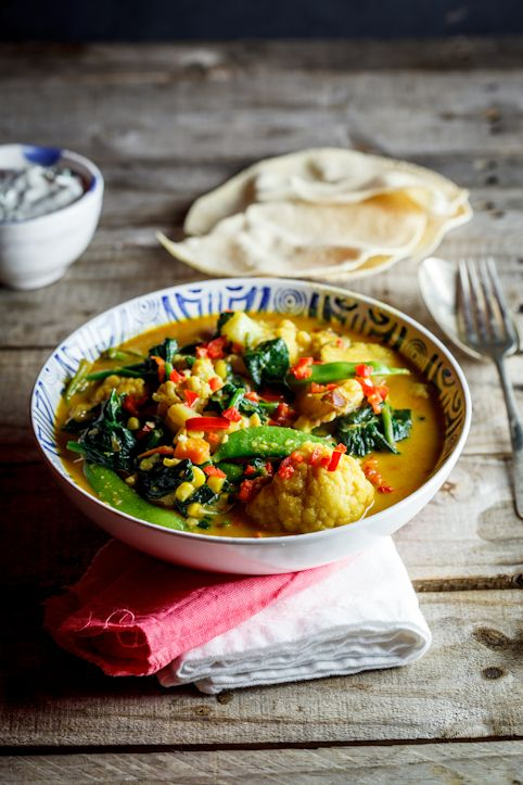 Delectable coconut-flavored vegetable curry with crunchy poppadoms.